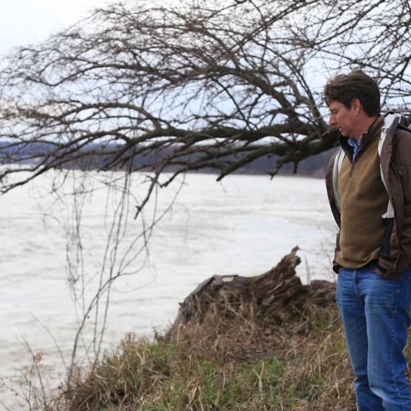 River Heritage Conservancy Executive Director Scott Martin looks upon the Falls of The Ohio on the Ohio River. Photo: Ryan Van Velzer/WFPL