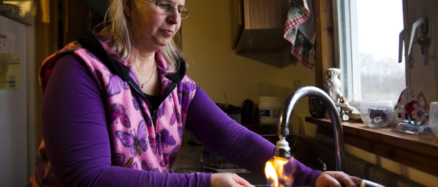 Woman lighting her water on fire