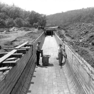 Workers lining the culvert.