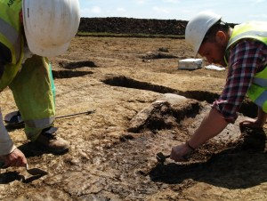 A Trainee Archaeologist excavating