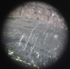 Small incised markings in the nickel inlay
