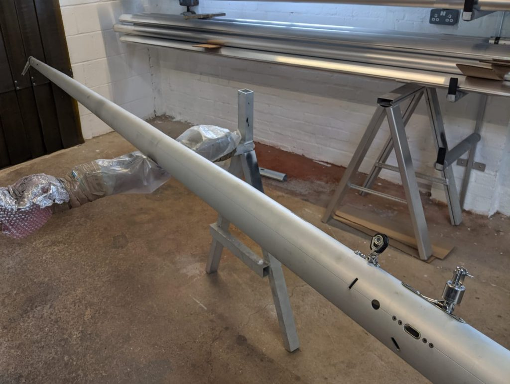 Finished tapered mast section