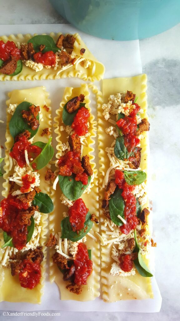 Easy, homemade, vegan & gluten free Lasagna roll-ups, made with tofu ricotta, and a flavorful vegan sausage crumble. Peanut & Nut free also.