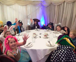 Kids table at event children wearing costumes