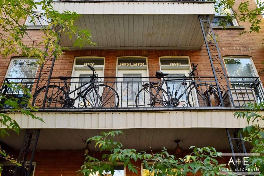 MONTRÉAL QUÉBEC - ALLEZ ELIZABETH - ROSEMONT LA PETITE PATRIE NEIGHBORHOOD - TWO BLACK BICYCLES ON A TERRACE