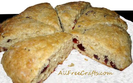 cranberry orange oatmeal scones cut in wedges