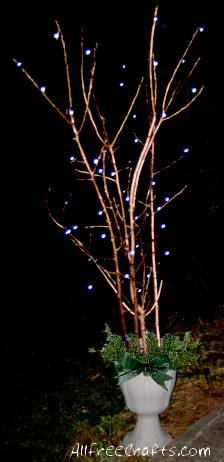 painted branches with Christmas lights