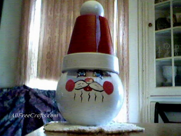 glass bowl santa with clay pot hat