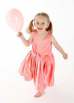 girl holding pink balloon