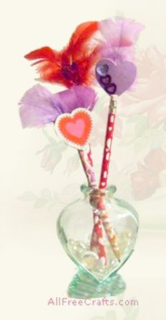 homemade valentine pencils with feathers and hearts