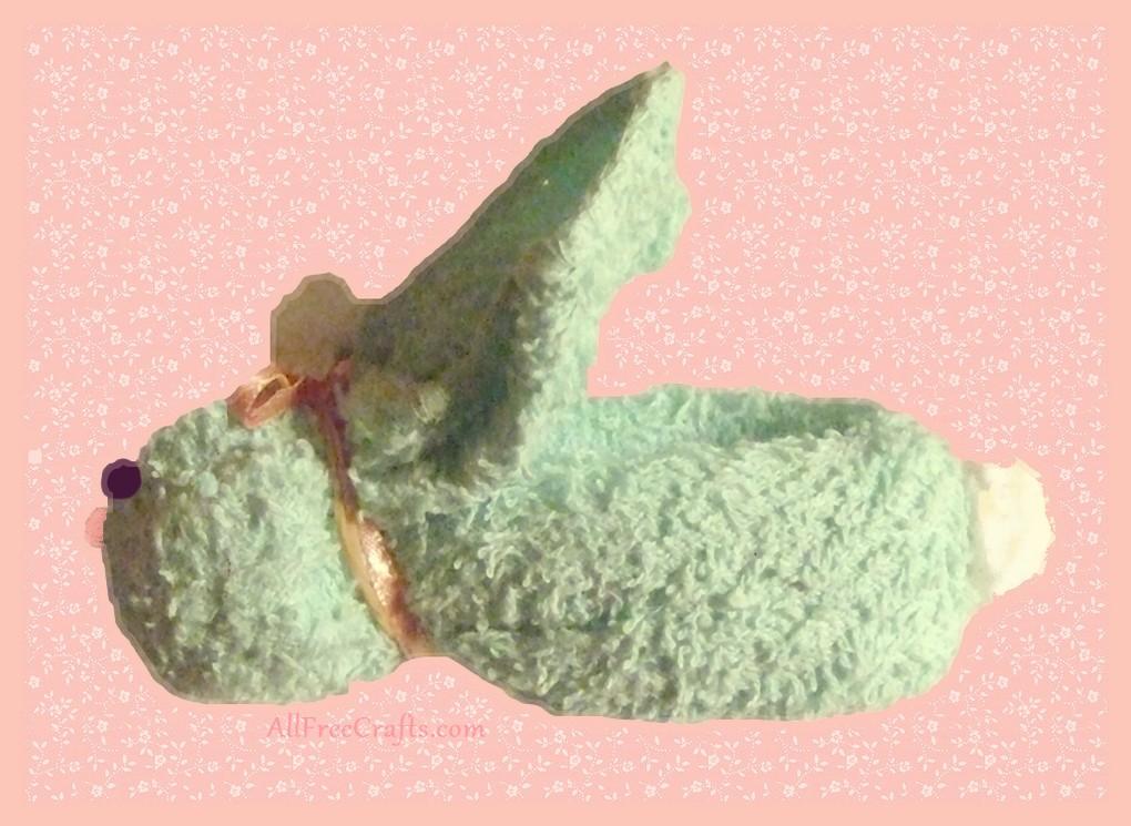 folded washcloth with bunny ears folded back