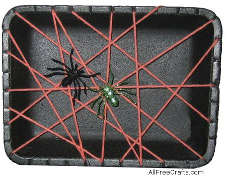 meat tray spider web