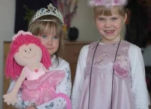 two girls wearing tiaras