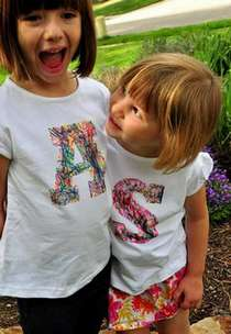 two girls wearing t-shirts decorated with their initials