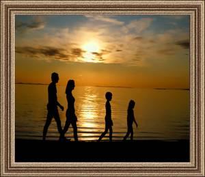 framed photo of a family on the beach