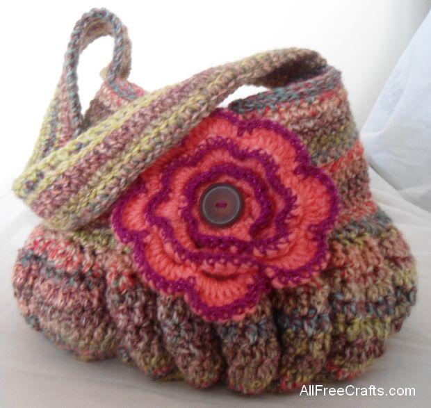 crocheted hobo bag with crocheted flower