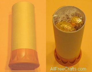 toilet paper roll wrapped in yellow construction paper with Tropicana orange juice lid base