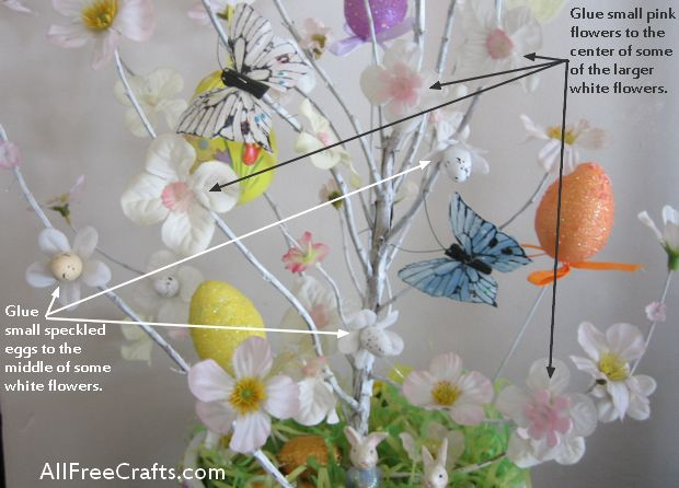 gluing flowers on a homemade Easter tree