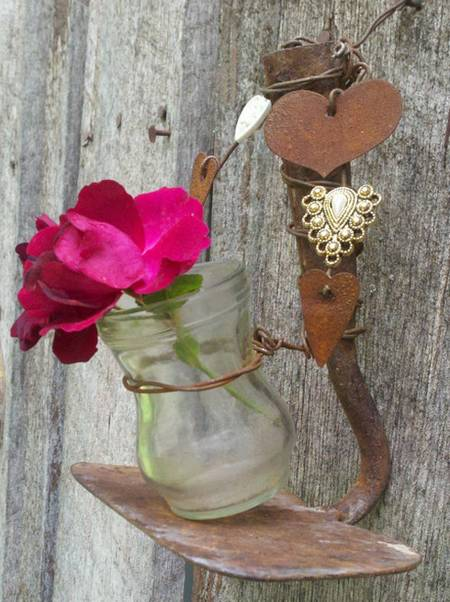 rusty hoe and jar vase