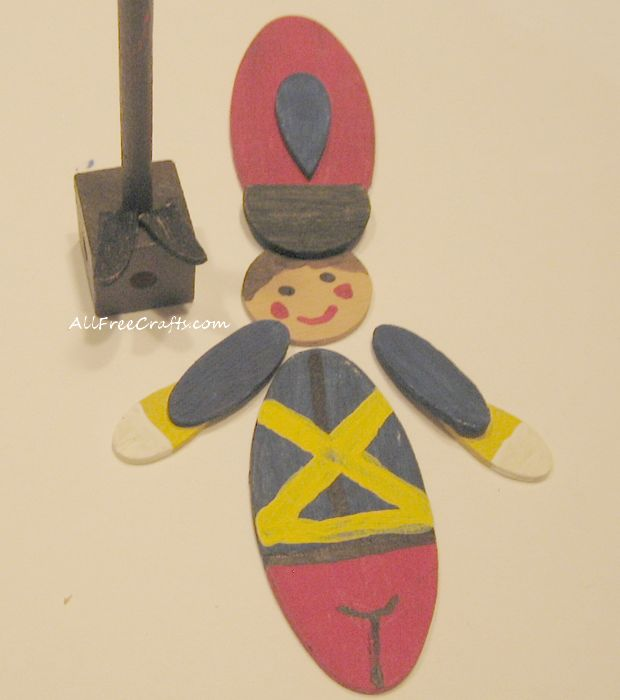 painting wooden shapes for toy soldier