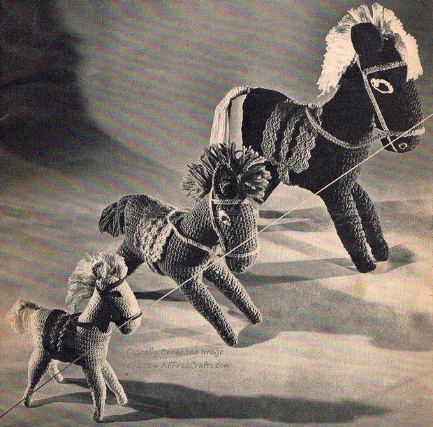 three crocheted horses