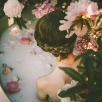 woman bathing in milk and roses