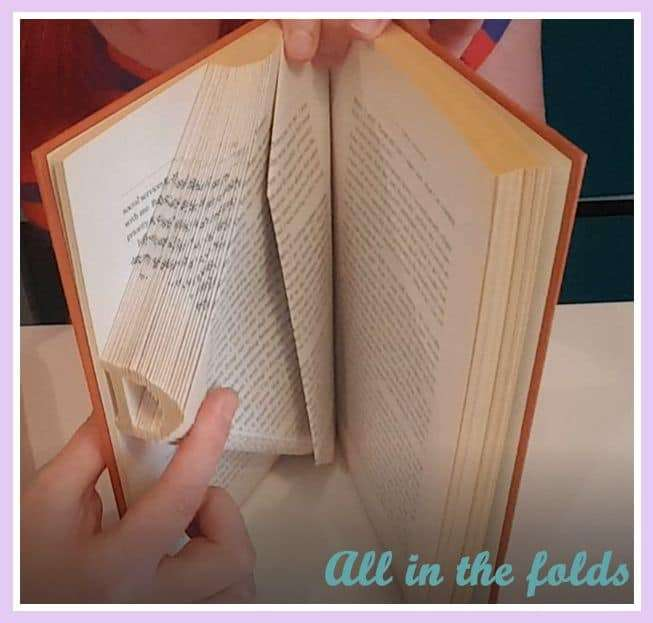 showing a page half folded as a spacer page