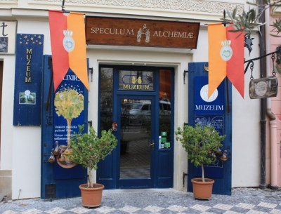Speculum Alchemaie entrance, with signage and plants and bottles on display