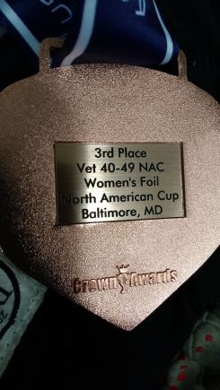 back of bronze medal. Reads: Third Place Vet 40=49 NAC Women's Foil North American Cup, Baltimore MD