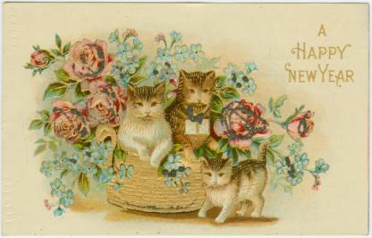 Nineteenth century illustration of three kittens in a basket. Text: A Happy New Year.