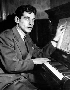 Twenty-five-year-old-Leonard-Bernstein-Assistant-Conductor-of-the-New-York-Philharmonic-Symphony-Orchestra-is-shown-at-the-piano-at-Carnegie-Hall-in-New-York-City-Nov.-14-1943.-AP-Photo-ASSOCIATED-PRESS