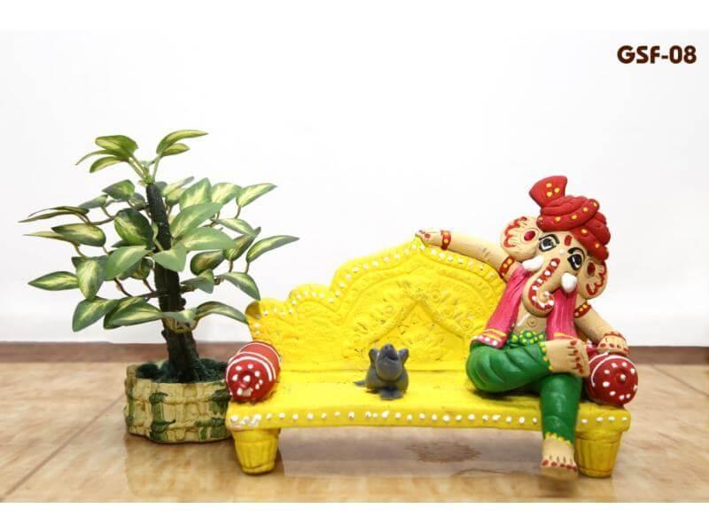 Terracotta Ganesh Sitting on Sofa (Height: 5 Inch, Width: 7 Inch)