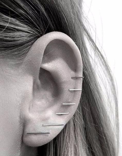 earrings, model accessories, designer earrings, designer ear cuffs, doir piercings,