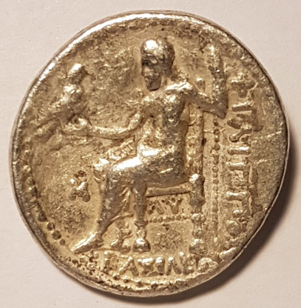 Zeus enthroned with his sacred Eagle is pictured on the reverse of the coin.