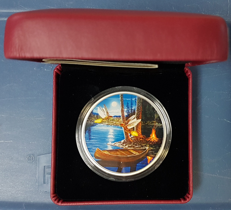 Fireflies colour coin in capsule in display case