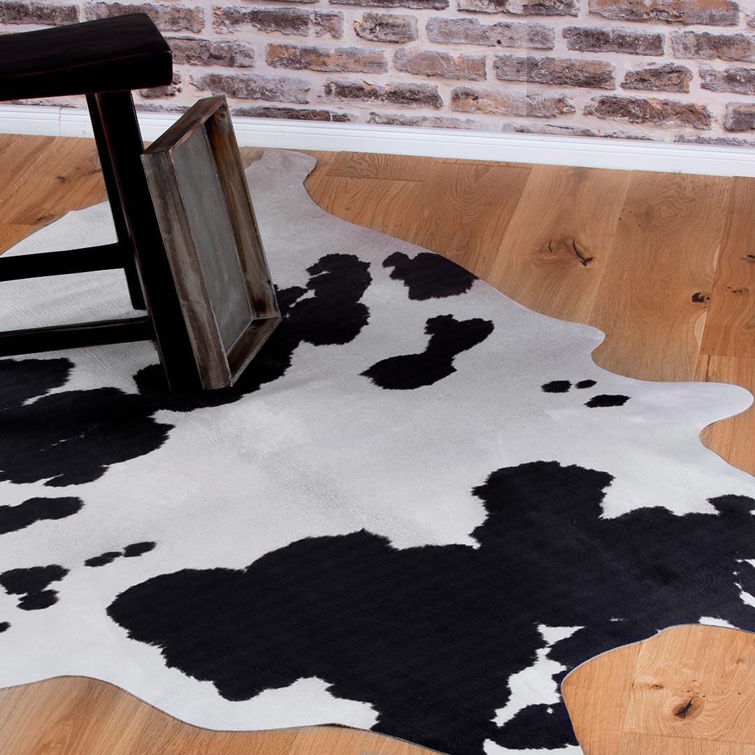 tapis imitation peau de vache noir et