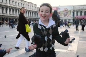 Feeding the birds in Piazza San Marco