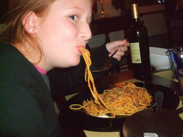An 11-year-old willingly eats a big plate of spaghetti with donkey meat sauce