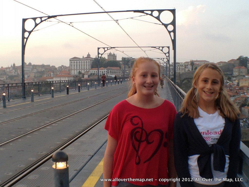 Walking across the Luis I Bridge in Porto