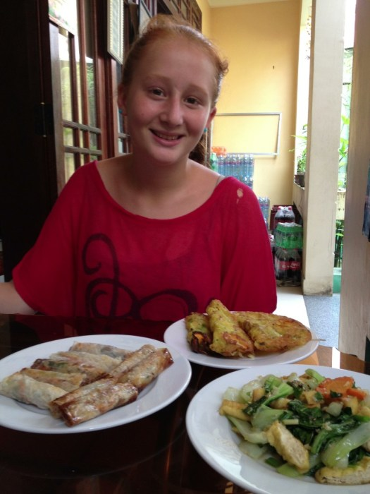 Calla with her spring rolls, crispy pancakes, and fried tofu and cabbage.