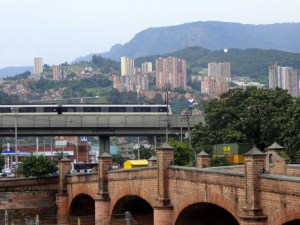 A train that's part of Medellín's impressive integrated transit system -- which includes rail, buses, cable cars, and free bicycles -- cuts through the city.
