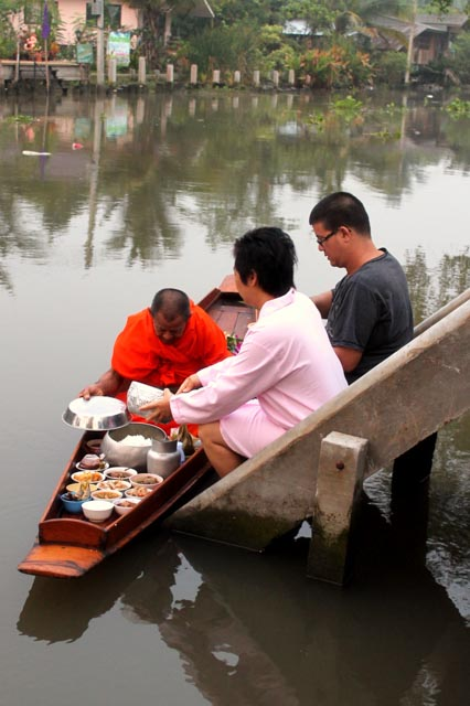 Morning offering in Thailand