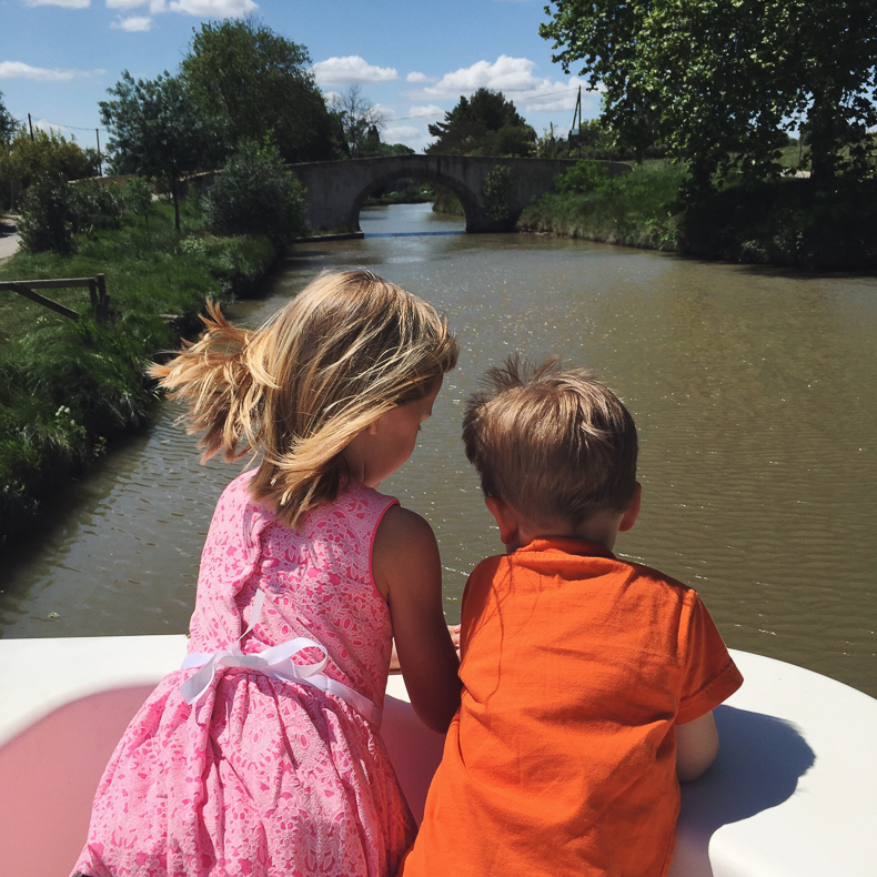 Two kids in the Canal du Midi on a Le Boat trip