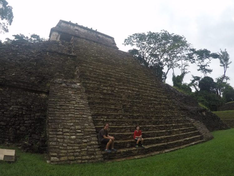 Coconut and J take a break from complaining to rest on the ruins at Palenque.