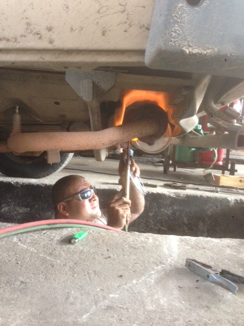 The mechanic, too cool in his shades, tires to set Wesley on fire