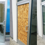 shop security door glass broken glass fix replaced and secured by northern ireland glazier commercial shop glass Belfast