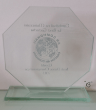 Solid block glass toughen glass trophy with sandblast and engraving of award and trophy in northern ireland