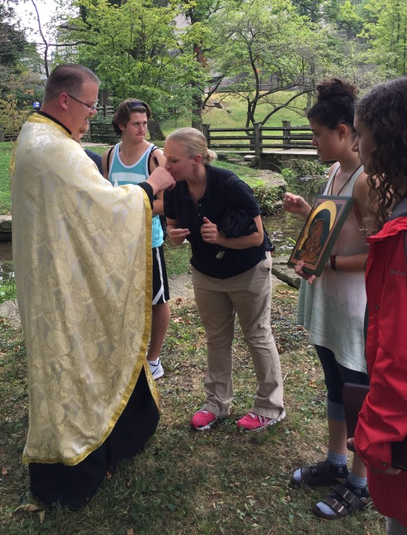 Venerating the cross and Fr. Peter's hand at the conclusion of the service