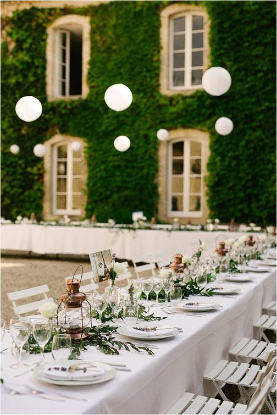 Tables and Lanterns at French Wedding Reception   Photo by CHRIS+LYNN Photographers