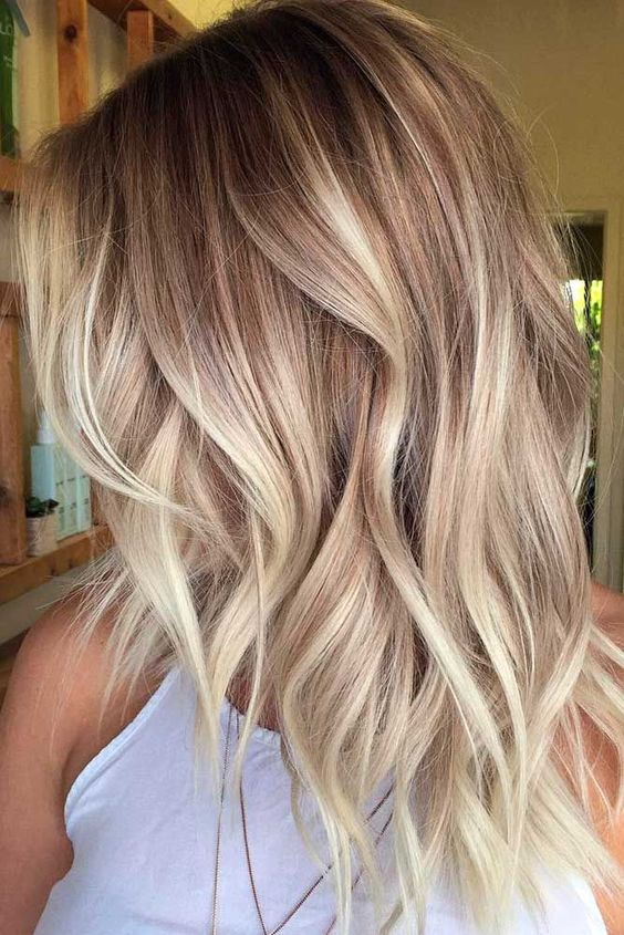 long blonde haircut curls celebrity hairstyle